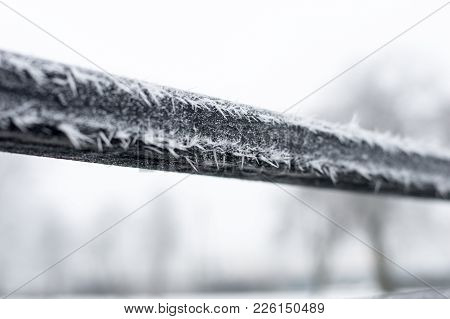 Hoarfrost On The Black Handrail In Winter Time.