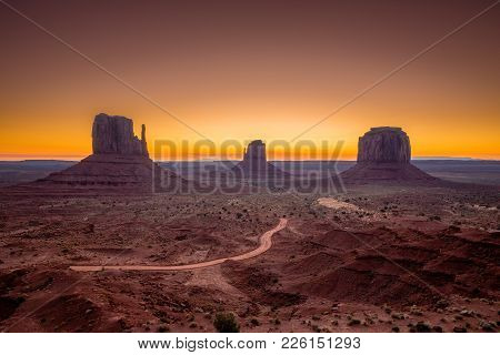 Classic View Of Scenic Monument Valley With The Famous Mittens And Merrick Butte In Beautiful Golden