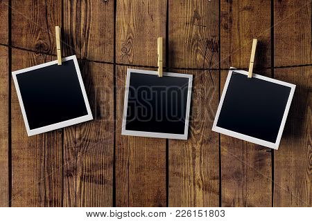 Blank Pictures Hanging On Wooden Wall Background. Photography And Art Concept. Mock Up, 3d Rendering