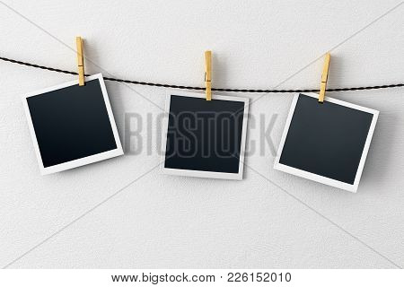 Blank Pictures Hanging On Concrete Wall Background. Photography And Art Concept. Mock Up, 3d Renderi
