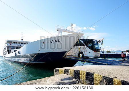 Igoumenitsa, Greece - May 17: The Corfu Ferry Is In Moorage And Bus Unloading On May 17, 2016 In Igo