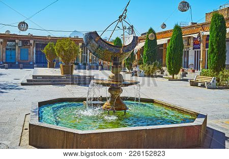 Isfahan, Iran - October 20,2017: The Fountain With Beautiful Sundial Decorates The Julfa Square, Loc