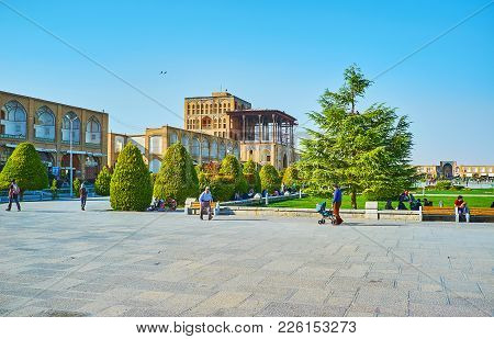Isfahan, Iran - October 20, 2017: Naqsh-e Jahan Square Is Famous Among The Tourists For Numerous His