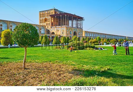 Isfahan, Iran - October 20, 2017: Nagsh-e Jahan Central Square With Green Park Is The Favorite Place