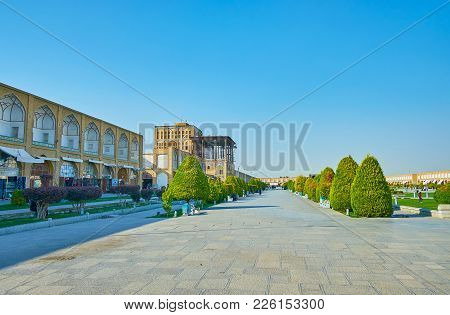 Isfahan, Iran - October 20, 2017: The  Walking Alley In Naqsh-e Jahan Square With Rows Of Trimmed Tr