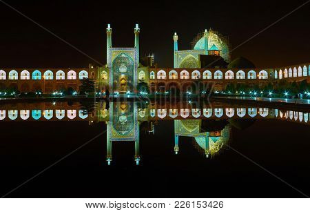 The Clear Night Reflection Of Illuminated Royal Mosque And Pavilions Of Grand Bazaar In Black Waters