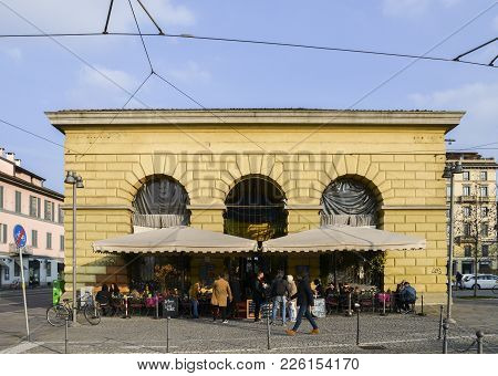 Milan, Italy - Feb 11, 2018: Italian Men And Women Have Lunch Outside At A Restaurant In The Porta T