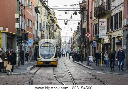 Milan, Italy - Feb 11, 2018: Yellow Milanese Tram At Busy Street In The Navigli District With Porta