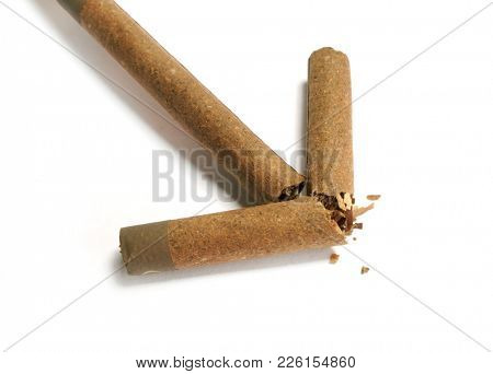 Cigars. Brown cigar on white background. Arrow of cigarettes