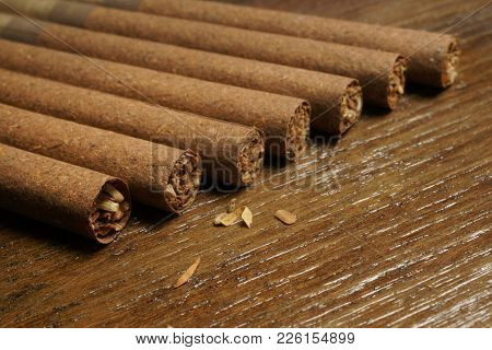 Cigars. Brown cigar on wooden background