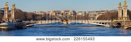 The Panoramic View Of Famous Alexandre Iii Bridge At Sunny Day In Paris, France