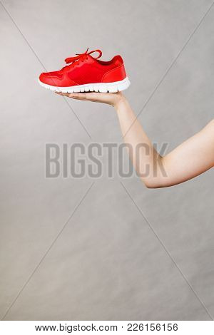 Woman Presenting Sportswear Trainers Red Shoes, Comfortable Footwear Perfect For Workout And Trainin