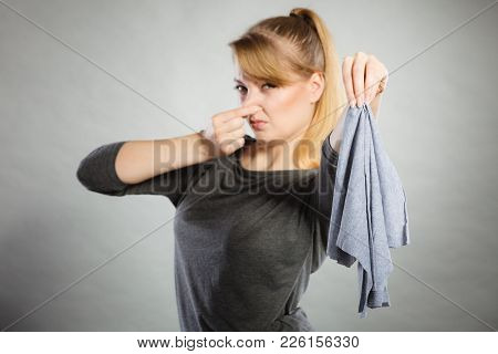 Household Duties Concept. Young Disgust Girl Holding Cleaning Cloth Rag Doing Domestic Chores. Unhap