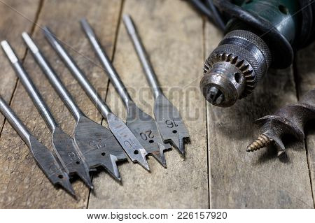 Joinery Tools In A Workshop. Drill, Hammer And Other Tools On A Wooden Workshop Table.