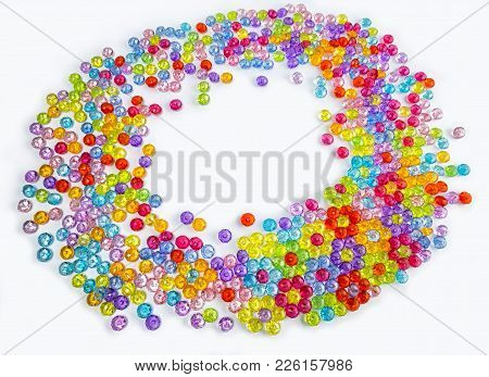 Acrylic Beads On A White Background. Acrylic Beads For Design. Top View With Copy Space For Your Tex