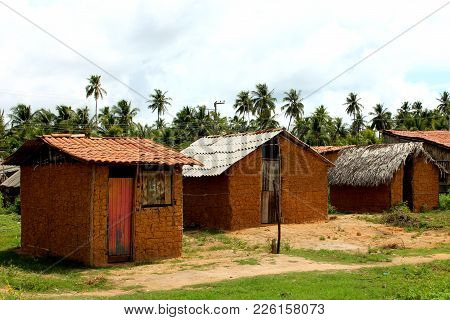 Three Simple Clay Houses Covered With Straw