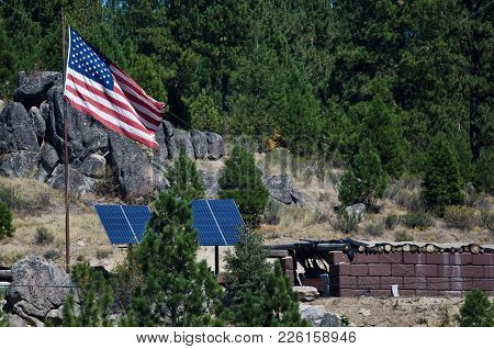 American Flag Standing Above Remote Outpost In The Wilderness