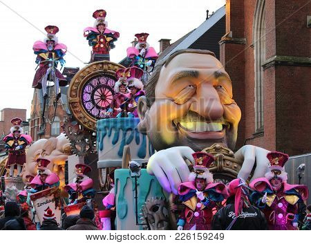 Aalst, Belgium, February 11 2018: One Of The Brightly Colored Floats And Participants During The Ann