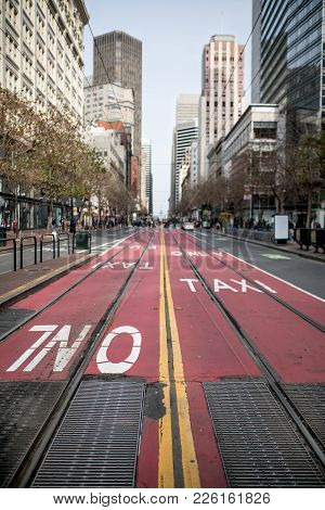 Street With Red Driveway With Tram Rails In San Francisco In California Usa. There Are People, Cars