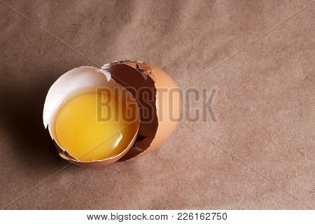 A Egg Yolk In Cracked Egg Shell