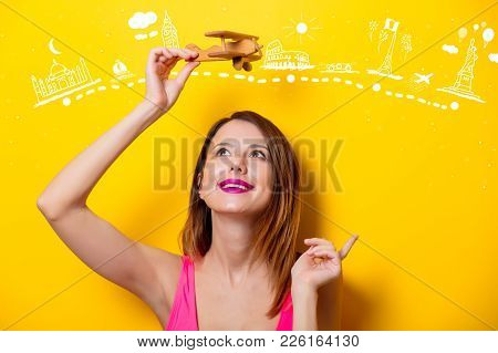 Girl Holding Wooden Toy Airplane On Travel Attraction