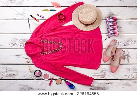Female Stylish Outfit And Cosmetics, Top View. Flat Lay Of Women Elegant Apparel And Makeup Accessor