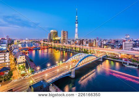 Tokyo, Japan skyline over the Sumida River.