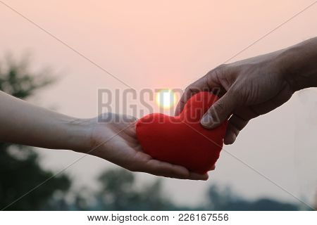 Give Love And Good Relationships With Heart, Two Hands , Lovers Give Love Each Other On Valentines D