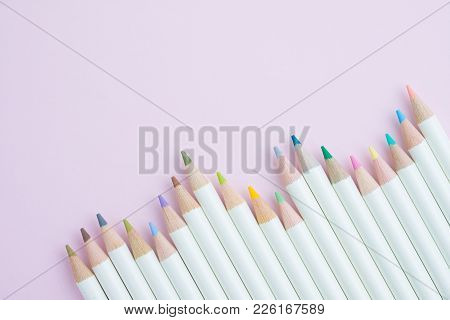 Various Color Pencils With White Wooden Handle On Sweet Pastel Pink Background Using As Art, Educati