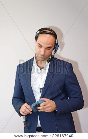 Businessman In Blue Suit With Voice Technology Computing Device