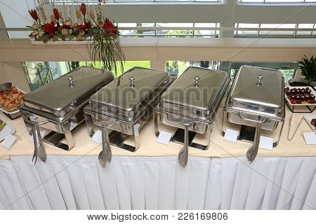 Stainless Steel Food Warmer At Catering Table