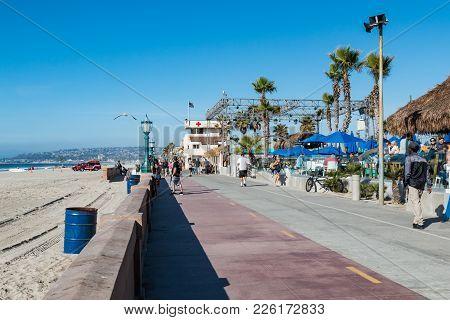 San Diego, California - February 9, 2018:  The Mission Beach Boardwalk, A Concrete Boardwalk Lined W