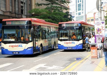 Kuala Lumpur, Malaysia - August 31, 2015 : People Waiting For City Bus At A Bus Stop In City Centre