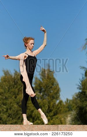 Young Graceful Ballerina Dancing Outdoors. Beauty And Grace Of The Body. Ballet Pas. Street Performa