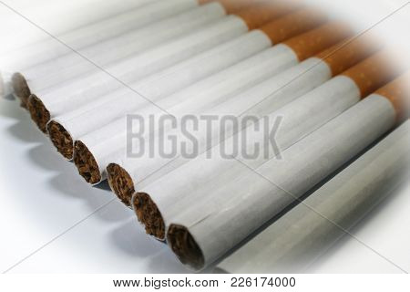 Cigarettes Lined Up Close Up With White Frame High Quality