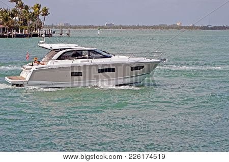 Upscale Cabin Cruiser On The Florida Intra-coastal Waterway Off Miami Beach.