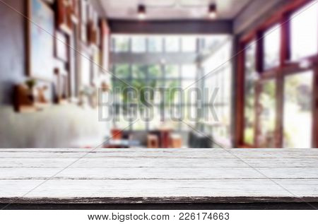 Selected Focus Empty Brown Wooden Table And Coffee Shop Or Restaurant Blur Background With Bokeh Ima