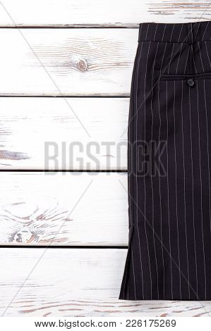 Women Formal Skirt And Copy Space. Female Black Midi Skirt On White Wooden Background. Feminine Clas