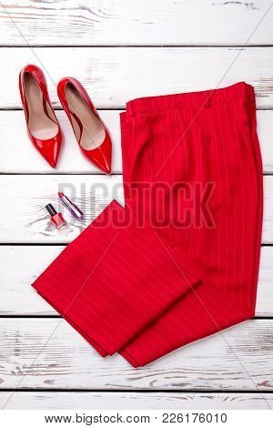 Women Red Classic Clothes, Top View. Female Red Elegant Trousers And Lacquered Heels On Wooden Backg