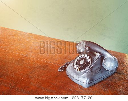 Close Up Broken Vintage Dial Telephone On Wooden Brown Table, Vintage Filter Effect