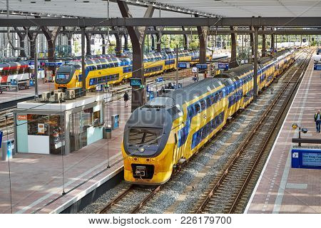 ROTTERDAM, THE NETHERLANDS - SEPTEMBER 20, 2017: Rotterdam Centraal, central station of Rotterdam with trains and platforms. The Netherlands has an efficient railway network