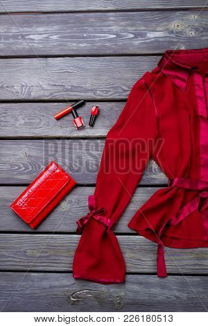 Ladies Red Elegant Blouse. Set Of Women Beautiful Red Shirt, Purse And Cosmetics On Old Wooden Backg
