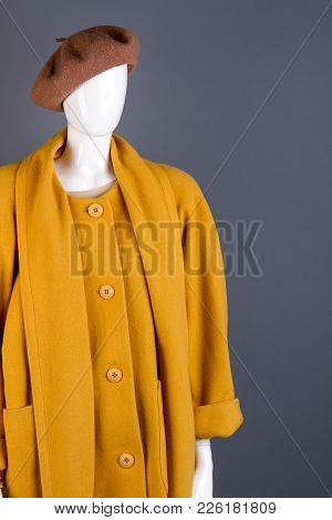Brown Beret And Cashmere Topcoat On Mannequin. Mannequin Dressed In Female Stylish Attire. Women Aut