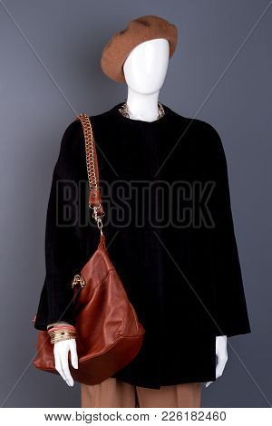 Female Mannequin With Stylish Brown Handbag. Dummy In Women Black And Brown Autumn Outfit. Feminine