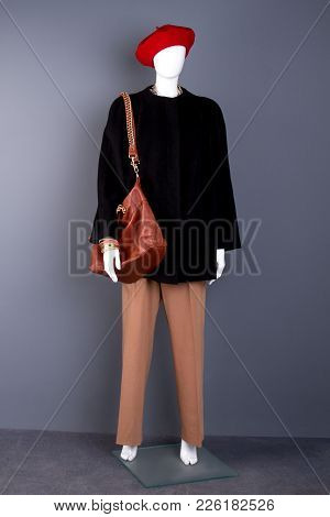 Full Length Mannequin In Modern Women Clothing. Red Beret And Black Coat On Female Mannequin. Ladies