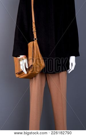 Female Mannequin In Classy Autumn Apparel. Feminine Black Jacket And Brown Trousers. Women Trendy Cl