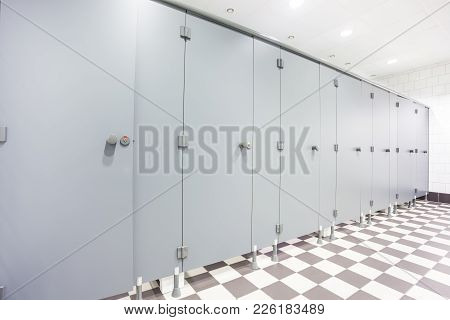 In An Public Building Are Womans Toilets Whit Gray Doors
