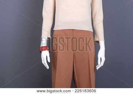 Beige Sweater And Brown Trousers On Mannequin. Female Simple Design Apparel And Accessories. Women G