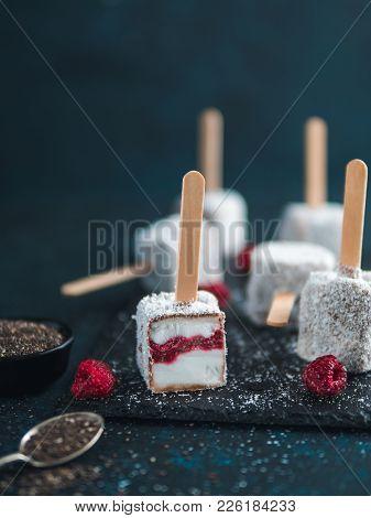 Homemade Raw Lamington Ice Cream Pops On Dark Background. Australian Sweet Dessert Lamington With Ch