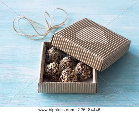 Delicious Homemade Candies With Peanut Butter, Chocolate Glaze And Waffle Crumbs In A Festive Craft